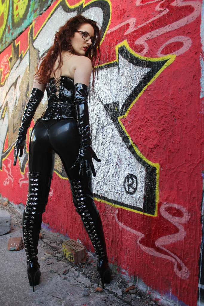 The mistress in a leather corset smokes sitting on the back of her husband wwwlifecamgirlscom - 3 3